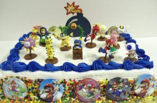 18 Piece Super Mario Brothers Cake Topper Set Featuring Running Mario with Turtle, Blue Toad, Yellow Toad, Pink Toad, Blue Yoshi, Pokey the Cactus, Puffer Blowfish, Dry Bones Dead Fish, Flyieng Mario, Decorative Bomb, and Coins Toys & Games