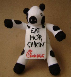 Chick Fil A Cow Mascot Stuffed Animal Plush Toy   6 inches   Cow is wearing a sign that says Eat Mor Chikin